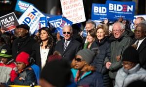 Jaime Harrison with presidential candidates Tulsi Gabbard, Joe Biden, Amy Klobuchar, Elizabeth Warren and Bernie Sanders in Columbia, South Carolina.