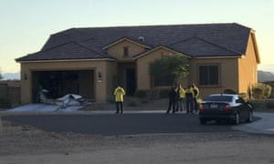 Police personnel stand outside the home of Stephen Paddock.