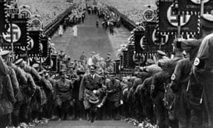 German chancellor Adolf Hitler amid huge crowds at a rally to mark the Bückeberg Harvest Festival on 1 October 1934.