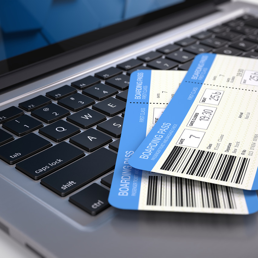 Two airline boarding pass tickets on laptop keyboard - online tickets booking concept. 3d rendering.