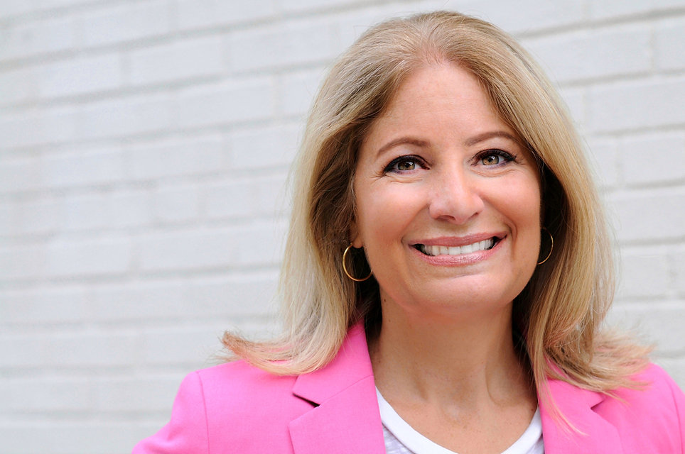 Leslie Boghosian Murphy headshot. Leslie is blonde and wearing a pink blazer.