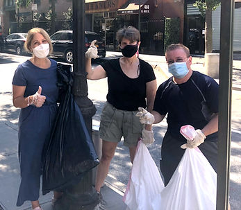 Leslie Boghosian Murphy wearing a mask and holding a trash bag with two members of the community doing a community clean up.