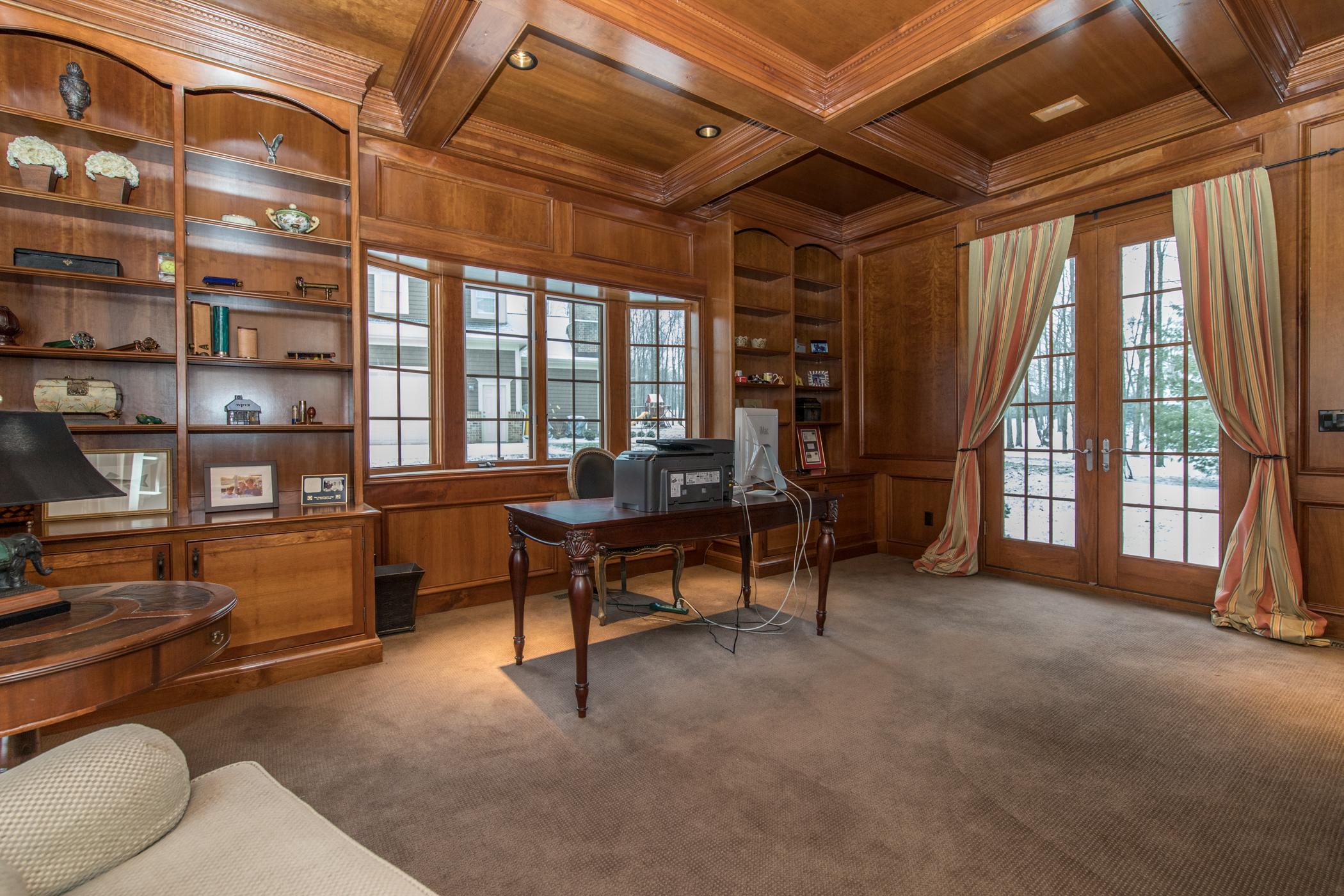 Handsome wood-paneled study