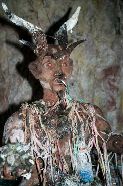 El Tío (The Uncle), is believed in Cerro Rico, Potosí, Bolivia as the Lord of the underworld. There are many statues of this devil-like spirit in the mines of Cerro Rico. El Tío rules over the mines, simultaneously offering protection and destruction. Some figures are really in the shape of a goat.   Miners bring offerings such as cigarettes, coca leaves, and alcohol for the statues and believe that if El Tío is not fed, he will take matters into his own hands.