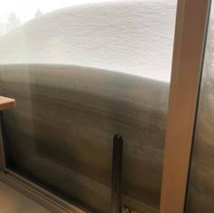 Snow piling up on window