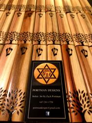 "5"" cedar wood mezuzah cases with Oregon Hillel's Tree of Life logo."