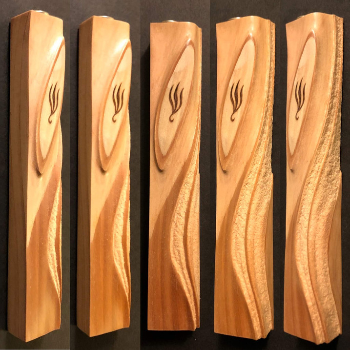 "5"" cedar wood mezuzah case that has been shaped by sandblasting."