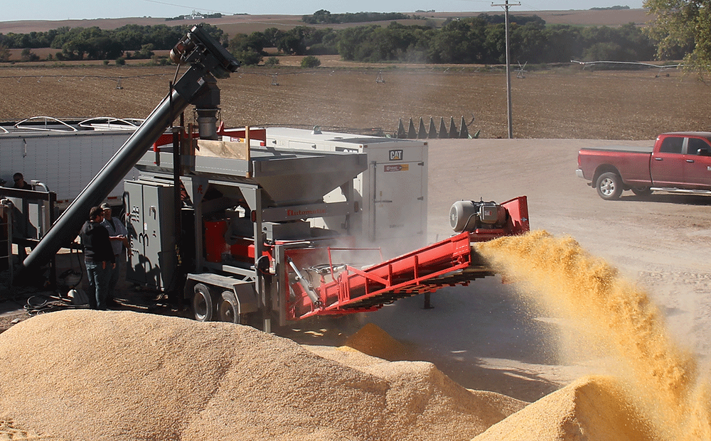 Farming operation grinding large amounts of grain with the AGT10000