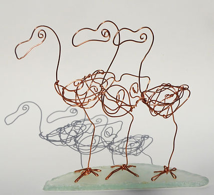 3 flamingoes. Copper wire on sea-glass base, indoor sculpture. Approx 15cm high.jpg
