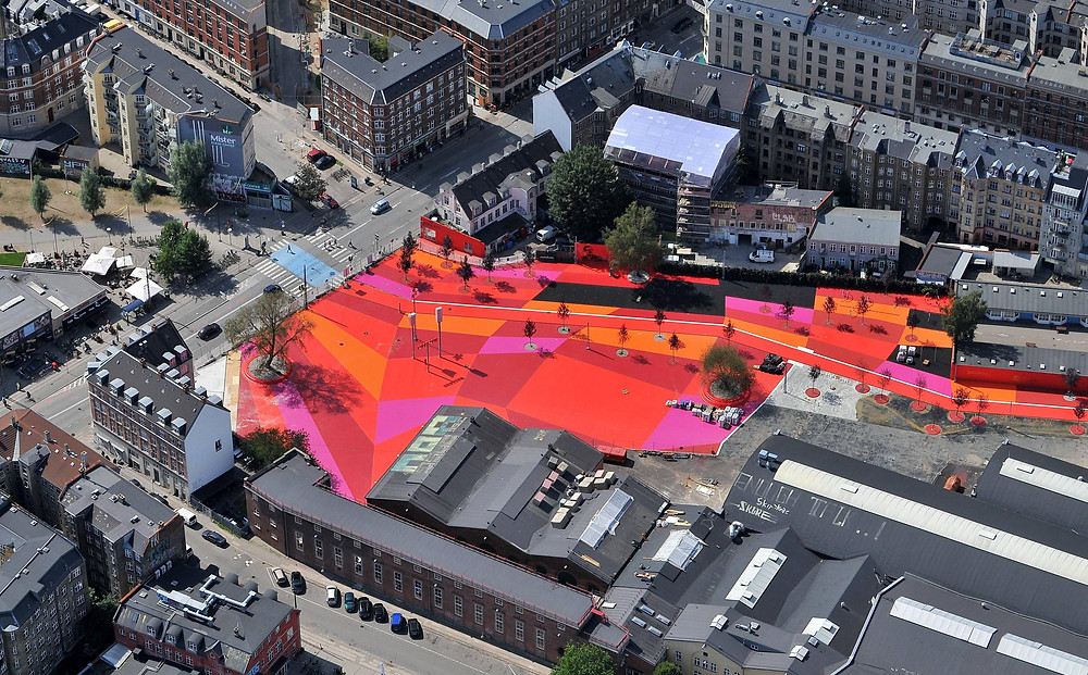 Superkilen park of the Danish architectural design firm-BIG, which uses a significant amount of color to give a spatial identity.