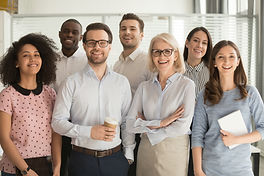 Smiling multiethnic employees standing l