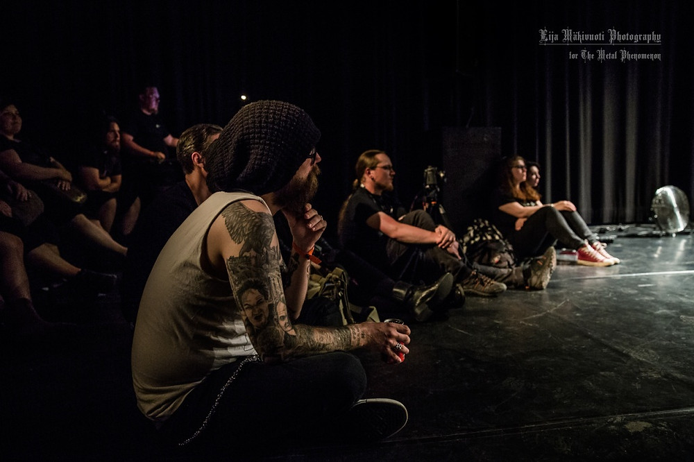 Vocalist Mikko Kotamäki came to sit down on the floor with the audience during 66°50´N,28°40´E. (Photo by Eija Mäkivuoti)