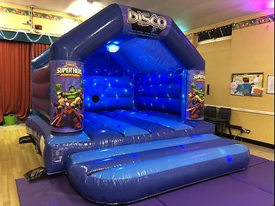 Disco Superhero Bouncy Castle Hire