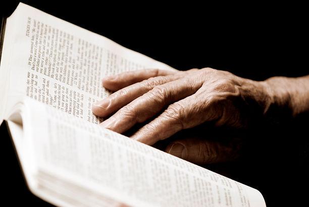 hands on a bible.jpg