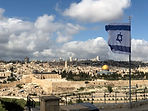 Israel flag above the old city of Jerusa