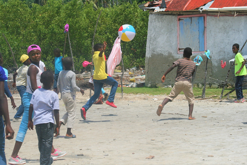 kids playing ball wearing their newly decorated hats