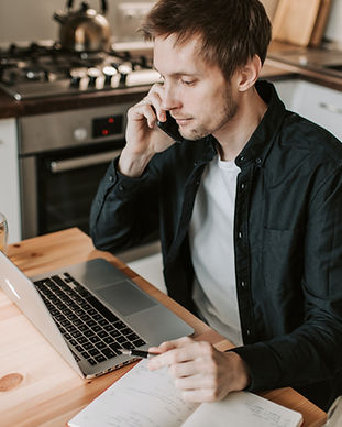 male-freelancer-making-phone-call-and-wa