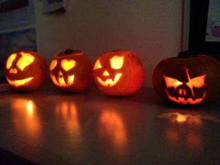 SKOLA students carve pumpkins for Halloween.