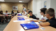 Upper-Intermediate students working in groups to practice their English