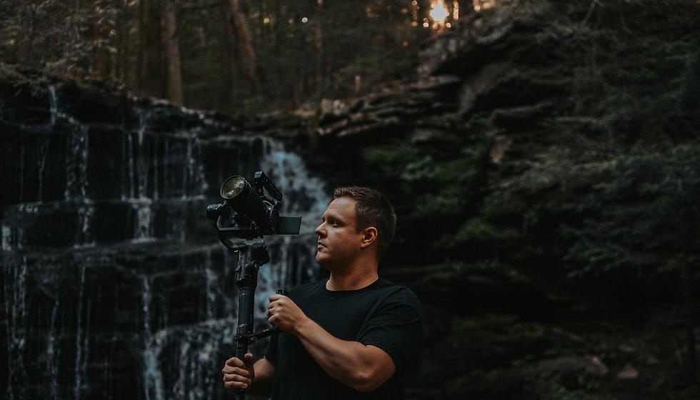 wedding videographer filming in the woods starta wedding films