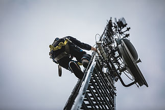 Telecom Worker Climbing Antenna Tower wi