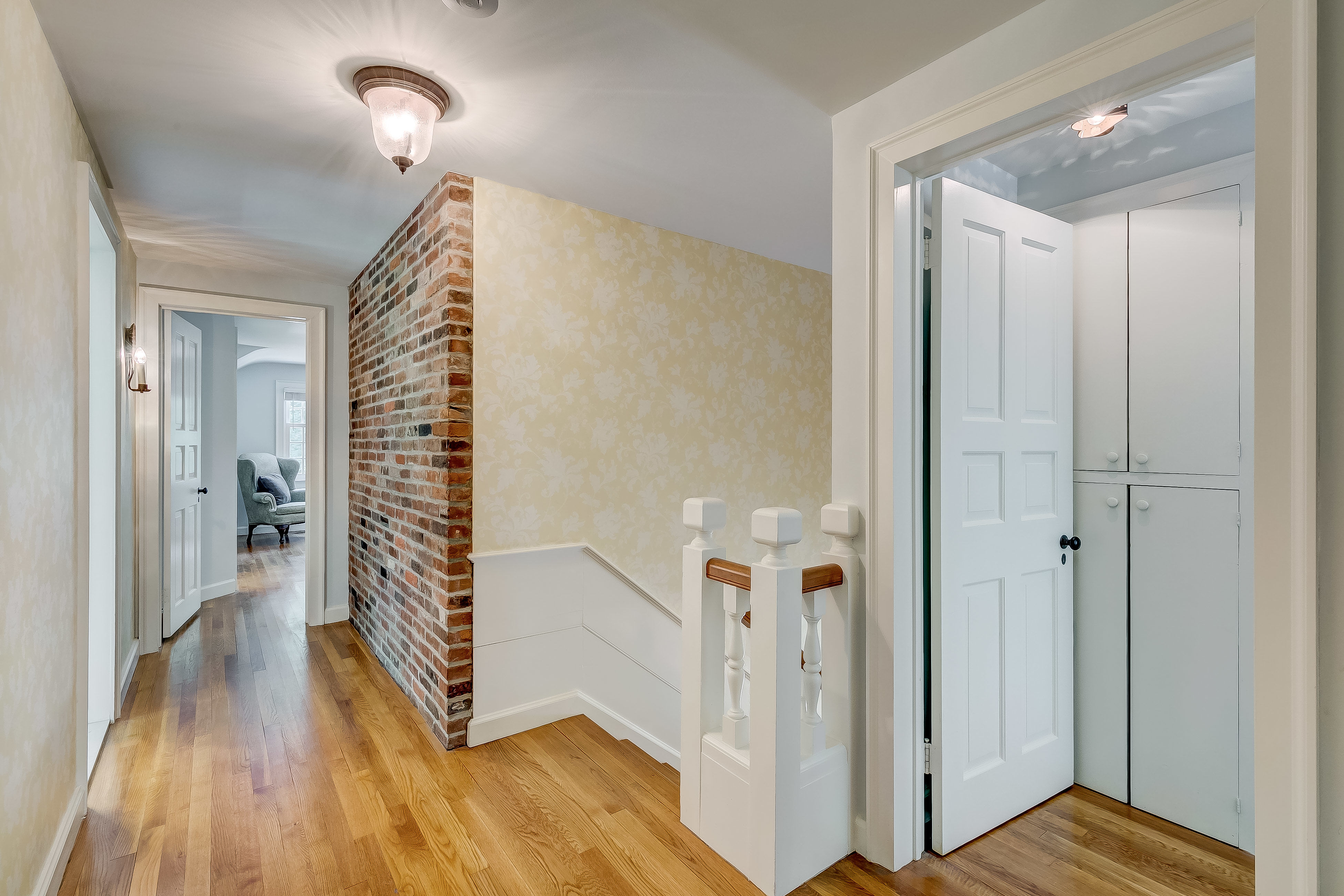 Exposed brick on second level