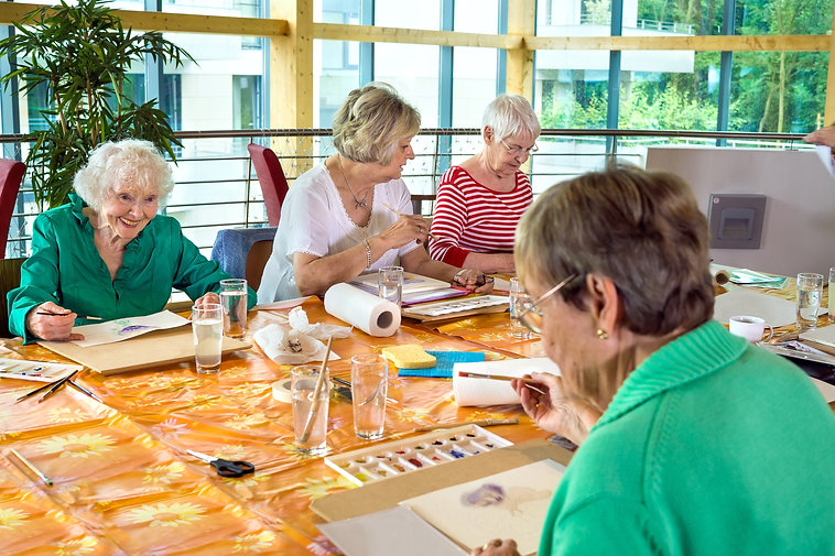 Group-of-cheerful-older-students-painting-together.-542933372_3869x2579.jpeg