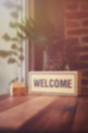 Welcome sign on the wooden table by the