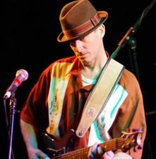 jim performing on guitar.jpg
