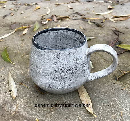 Handmade ceramic cup decorated with multi-layered Celadon glazes to give my 'Going Grey' speckled effect