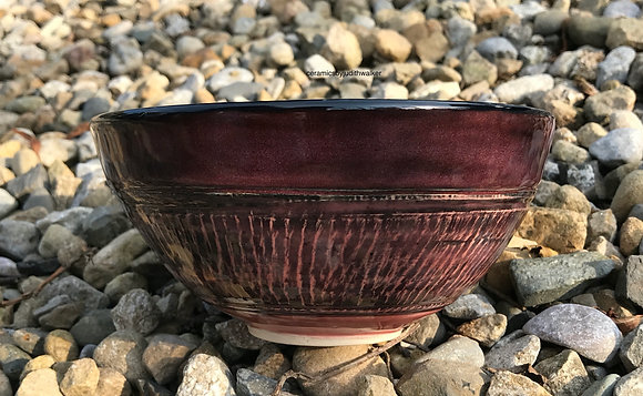 Handmade ceramic bowl with incised exterior decoration and 'dotty' interior - exterior image