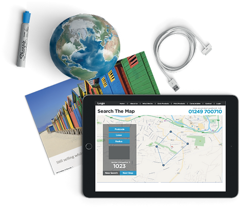 An ipad showing map search surounded by other office items.
