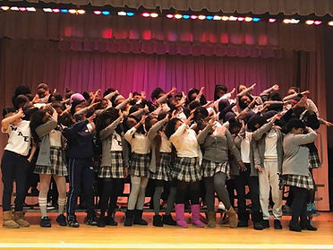 Group of WAE seniors in school uniform, dabbing.