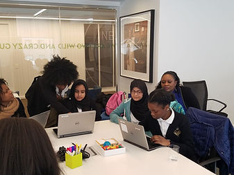 Students working on laptops at a Girls Tech Conference