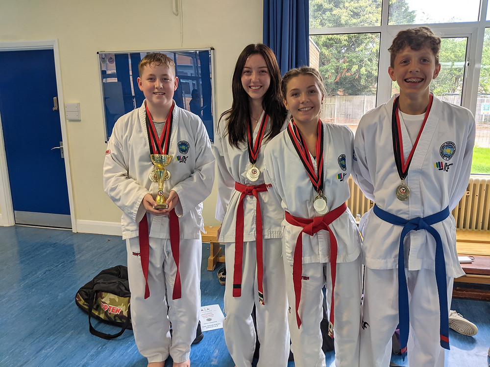 4 TaeKwon-Do Students showing medals won by Banstead TaeKwon-Do