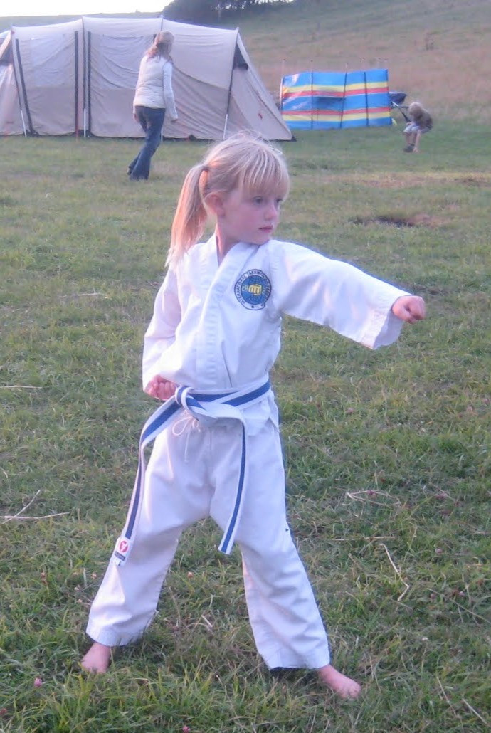 Banstead Tiny TKD student doing a punch