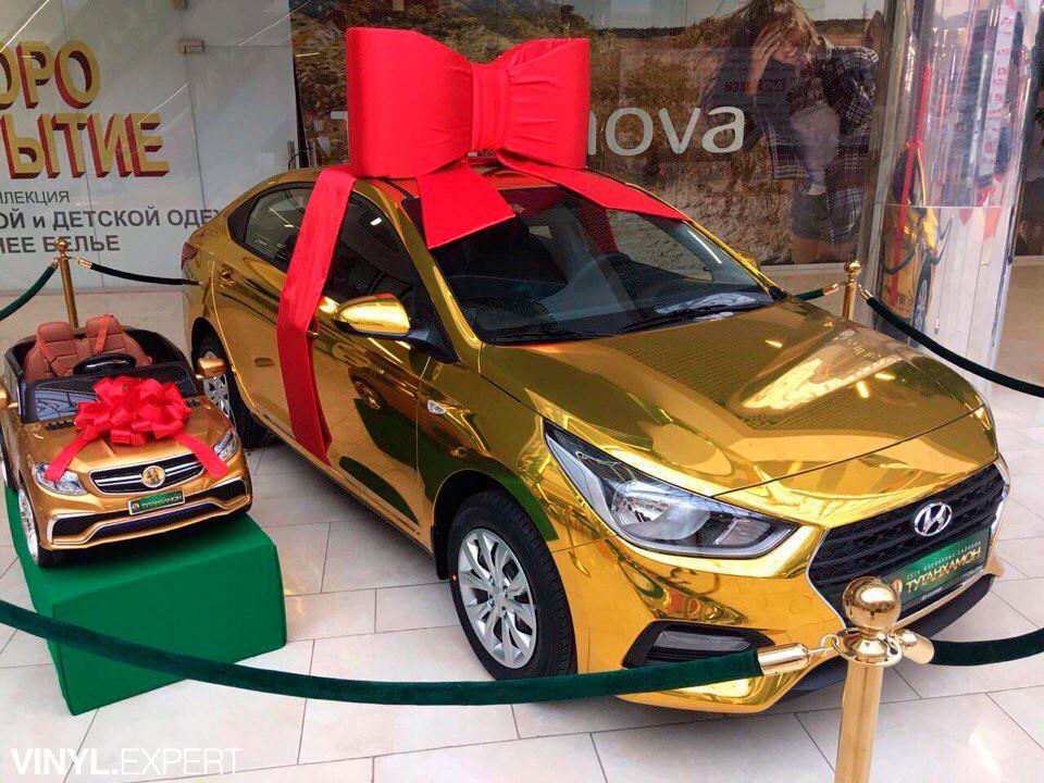 Оклейка авто золотым хромом