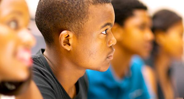 Black-students-listen-in-class-Shutterst