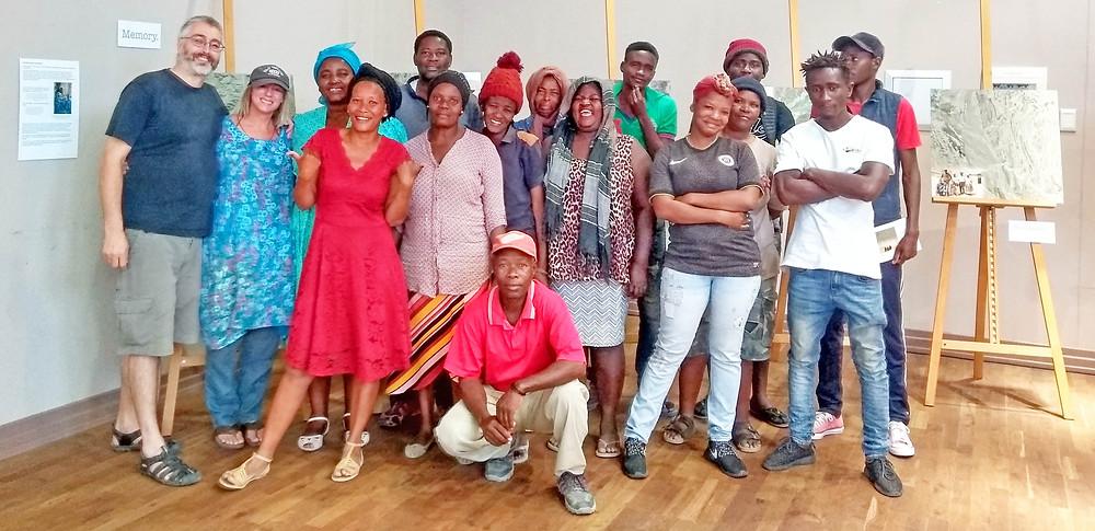 Swakopmund residents from Sesfontein visit exhibition on 150619, Mike Hannis, Sian Sullivan & Welhemina Ganuses to left of image