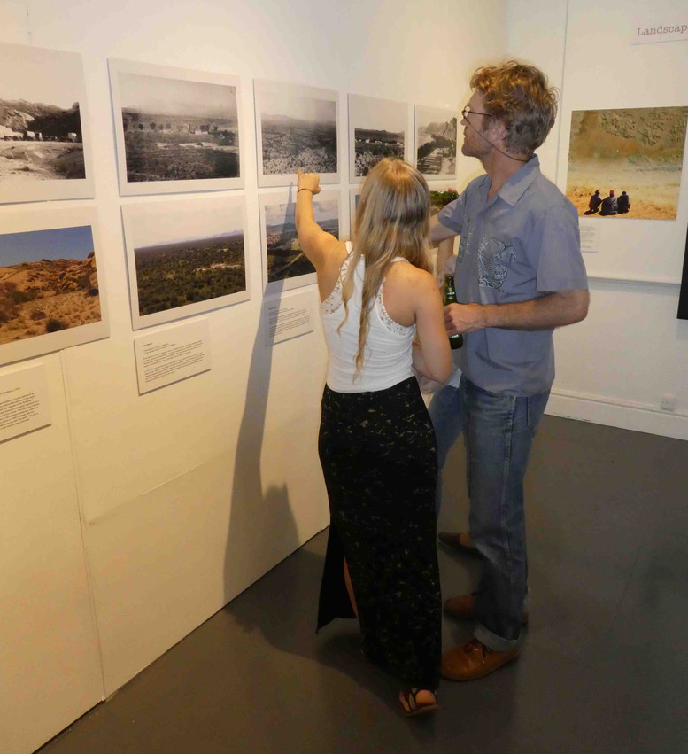 Morgan and Andy Botelle look at Rick Rohde's repeat landscape piccies