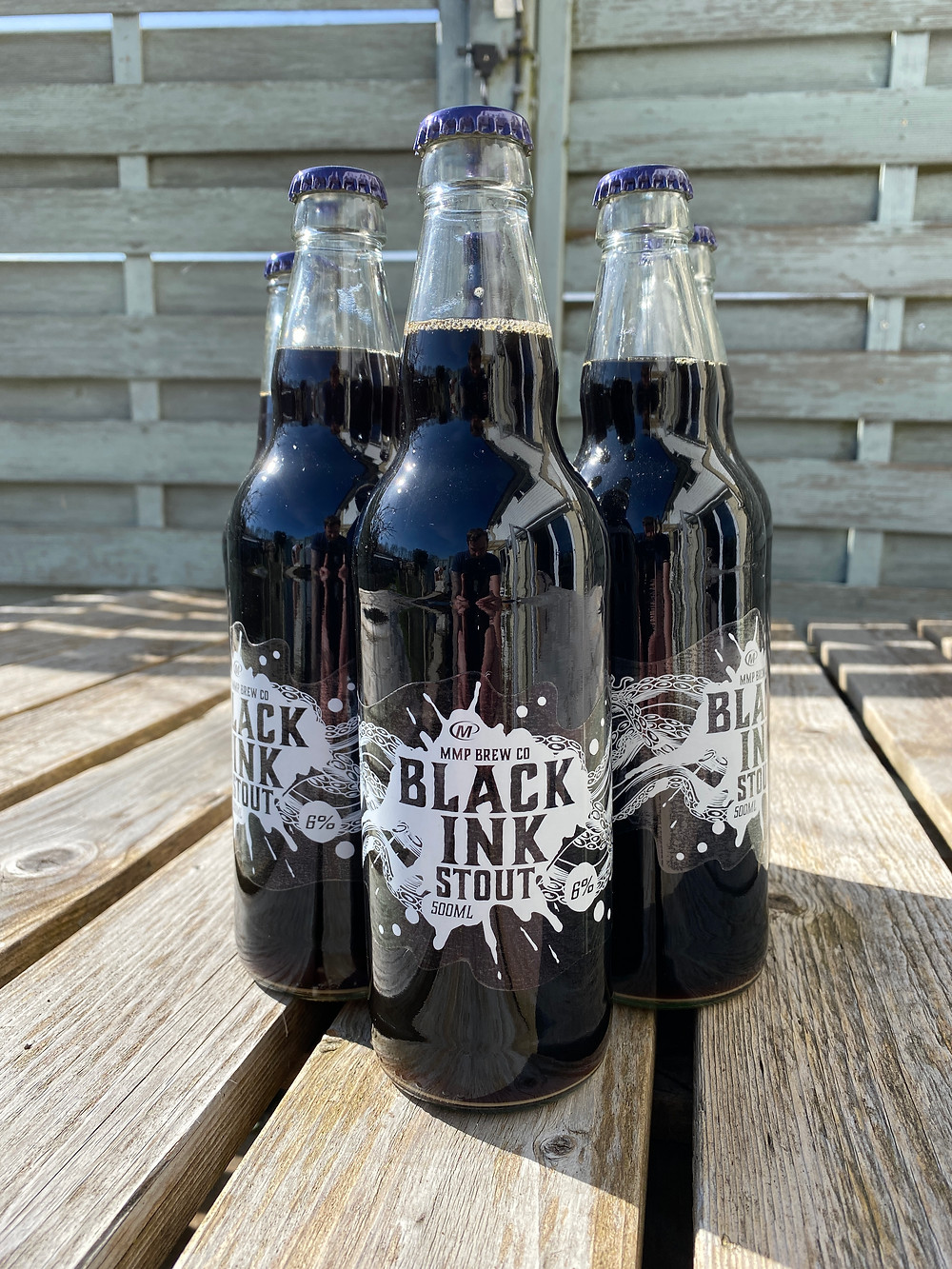 Beer bottle labelling using our clear plastic stock and white print.