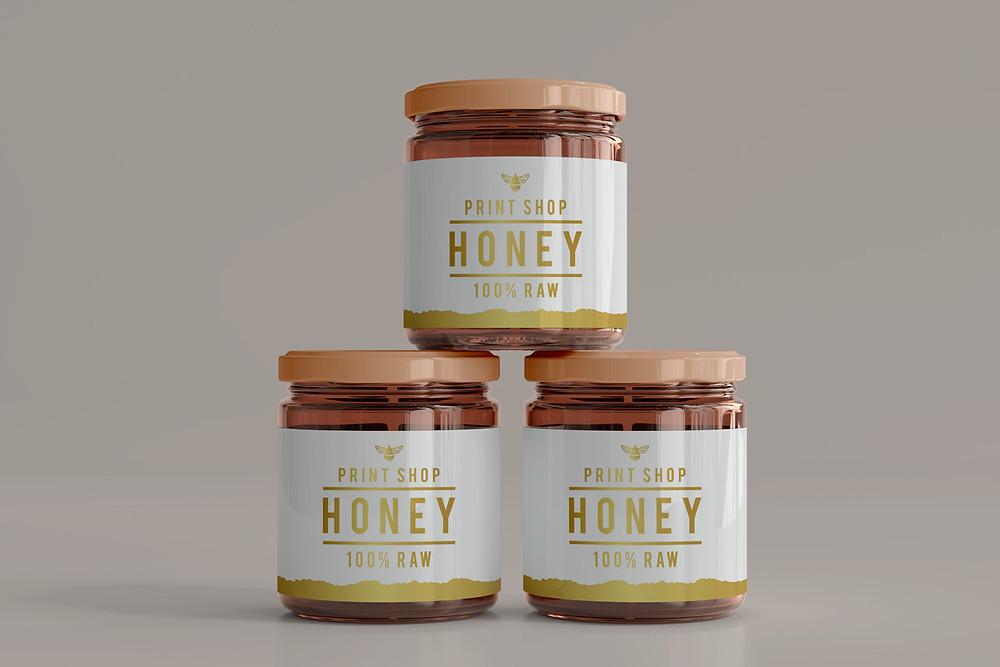 Branded self adhesive labels on jars of honey