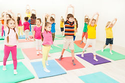Canva - Kids Stretching during Gymnastic