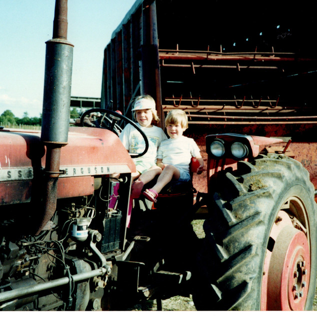 Sisters driving the tractor