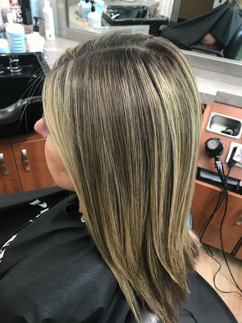 After a keratin service and lowlights to tone down her highlights