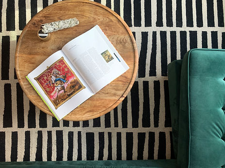 Coffee table layout, sage, black and white rug