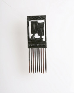 Stylized wooden comb sculpture
