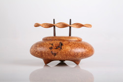 Wooden urn with sculpted handle