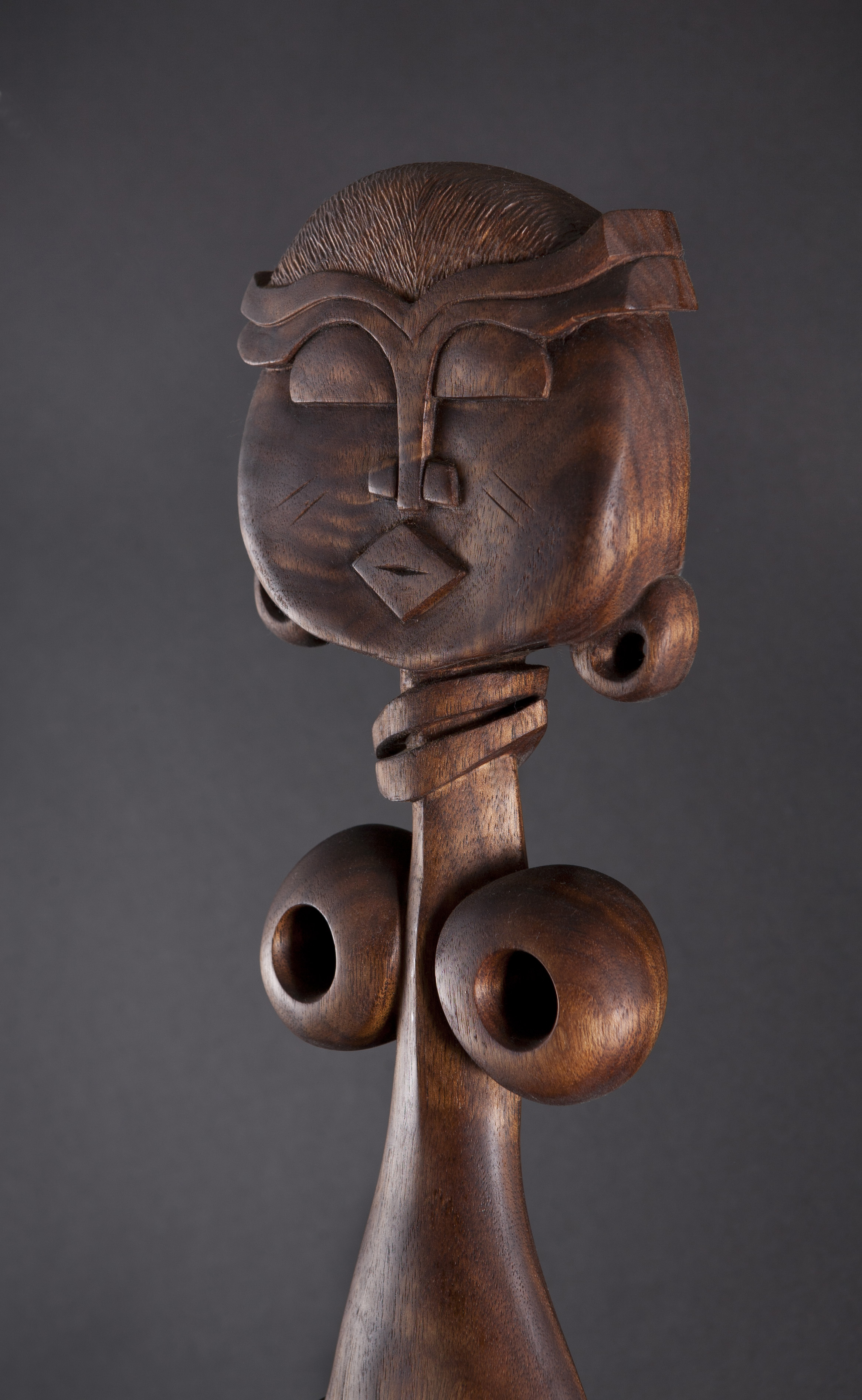 Stylized African fertility comb