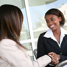 bigstock-Business-Woman-Handshake-302030